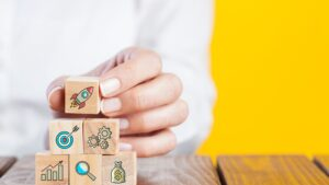 woman holding cubes with startup icons